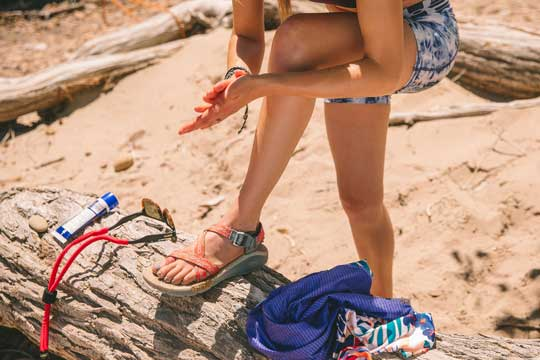 Woman on beach in Chacos
