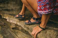 close up of chacos on rocks