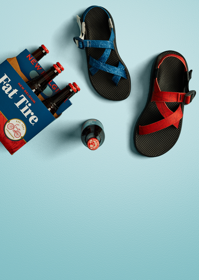 A 6 pack of Fat Tire next to our Chaco X Fat Tire Collaboration sandals.