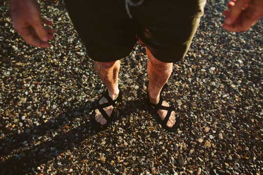 Man on the beach in Chacos