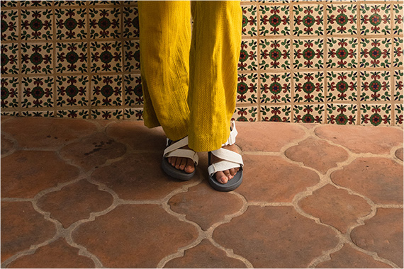 Standing feet together on a double-sided spade shaped tile floor.