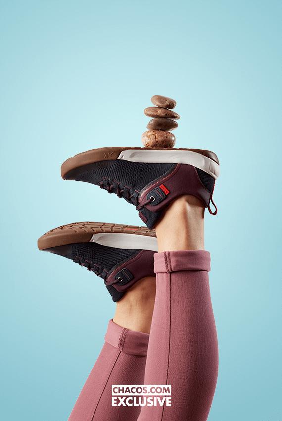 Chaco Sidetrek shoes balancing 4 rocks.