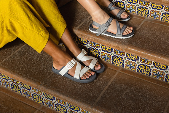Rocking some Lowdown sandals sitting on some tiled steps.