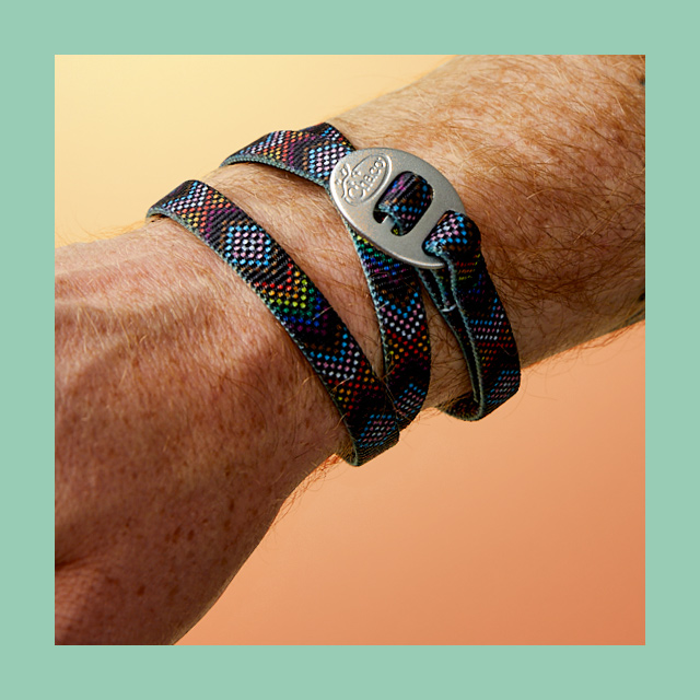 A colorful Chaco friendship bracelet wrapped around a wrist.