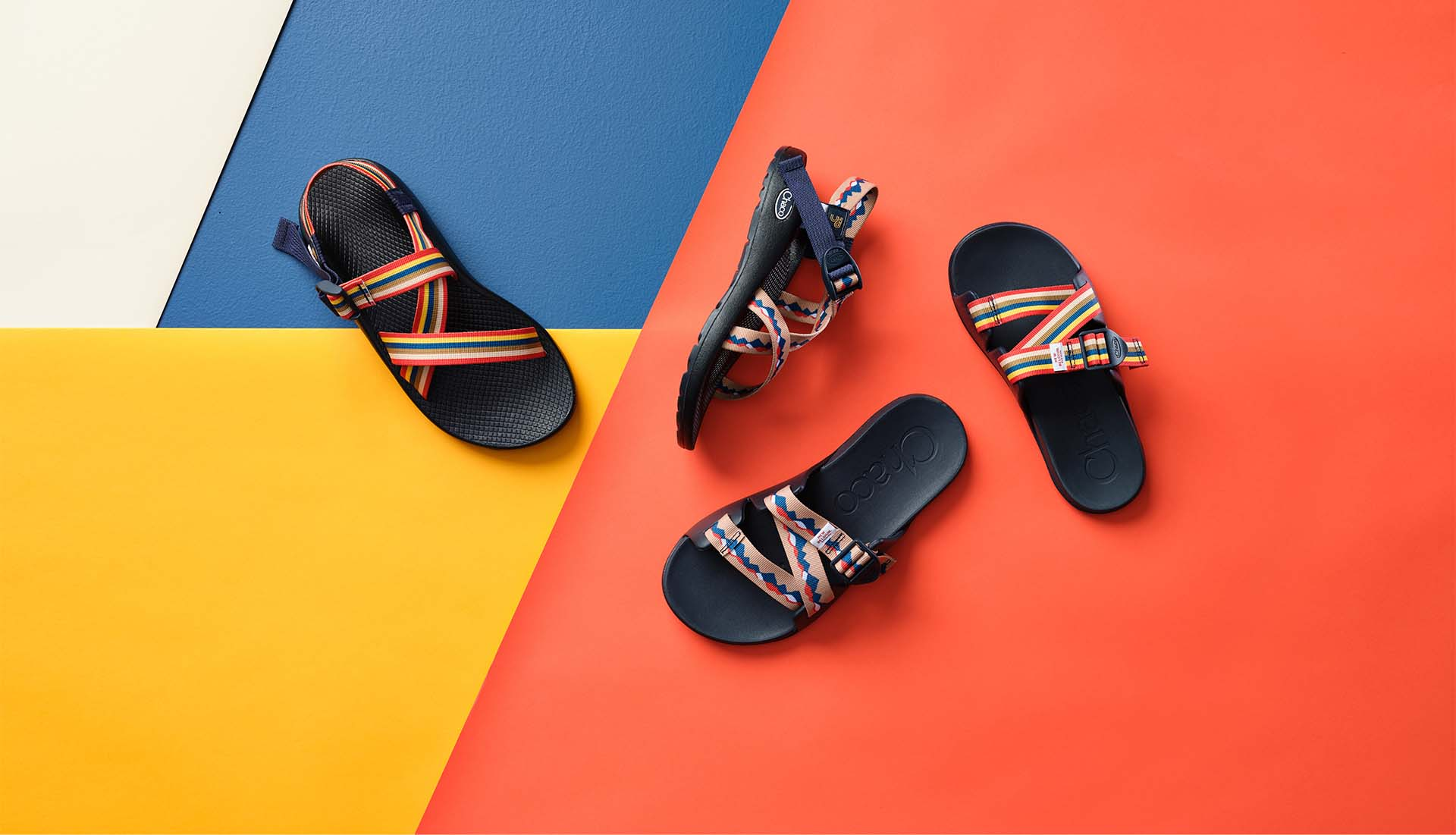 Selection of Chaco and New Belgium Brewing collaborative sandals on a colorful, geometric background.