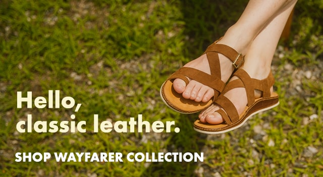 Woman wearing Chaco Wayfarer sandals outside on a sunny day.