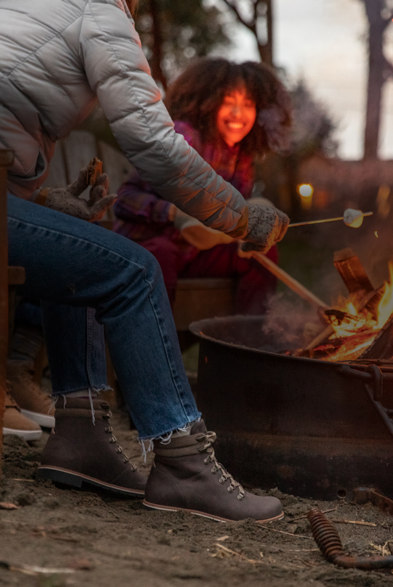 Roasting marshmallows by a campfire wearing a pair of catalunas.