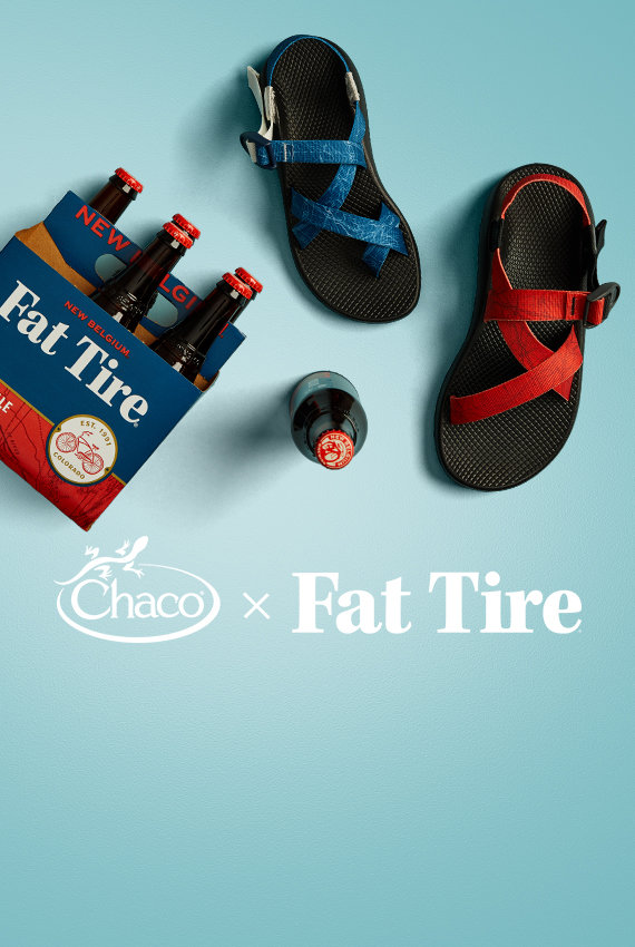 A six pack of fat tire next to a pair of the sandals.