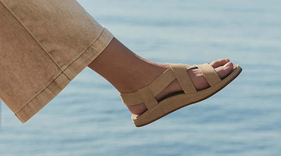 Person sporting tan Chaco Wayfarer sandals.