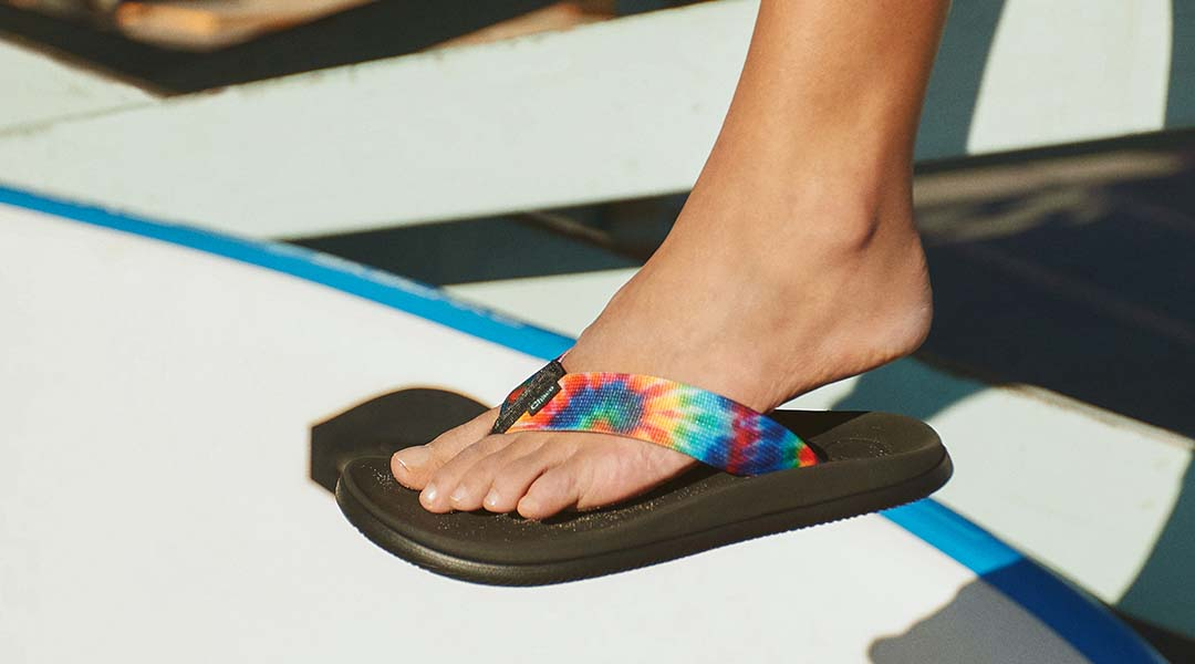 Person sporting Chaco tie dye flips.