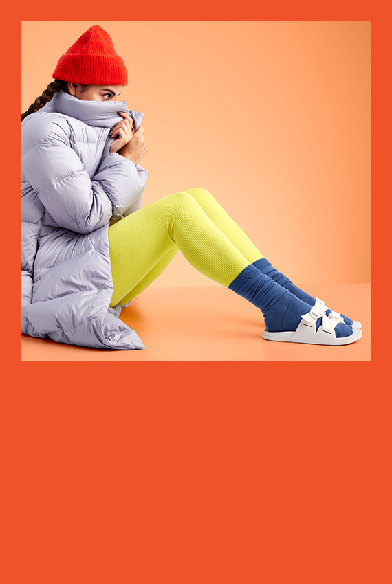 A girl bundled up in winter attire wearing some Chillos with socks.