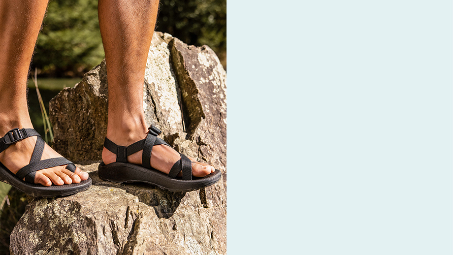 Rocking the classic Z sandals atop a boulder.