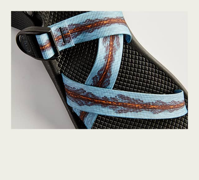 Person assembling a Chaco sandal.