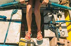 Woman crouching in Chacos