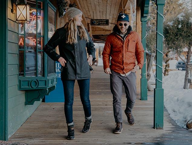 A man and women window shopping outdoors.
