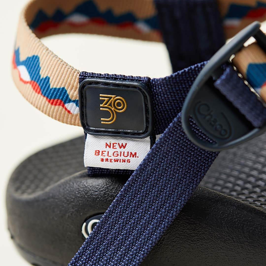 Detail showing custom badge of a z/sandal, New Belgium Brewing collaborative sandal.