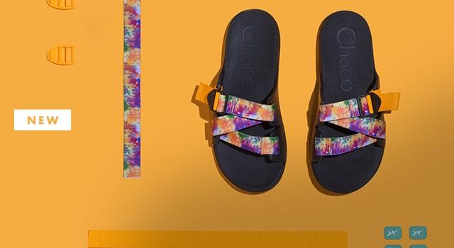 A pair of custom tie dye sandals.